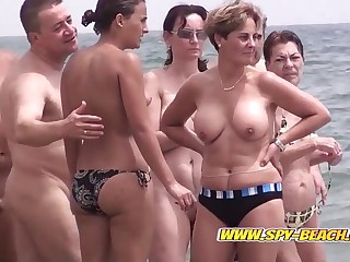 Hidden cam on a Spanish nudist margin