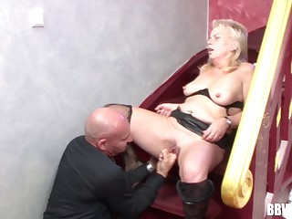 Wild fucking on the stepladder between an old bald lady's man and a mature slut