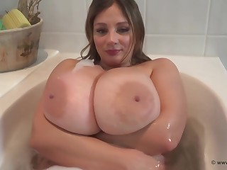 Big titted gal is having a relaxing bath nigh front of the camera and enjoying it