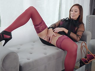 Horny stepmom Christy Adore is masturbating in the living room